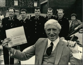 Jimmy Savile presents a cheque to Jersey Police.