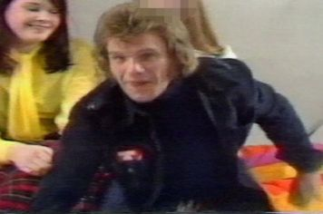 Karin Ward (in yellow) behind Freddie Starr on Clunk Click 1974